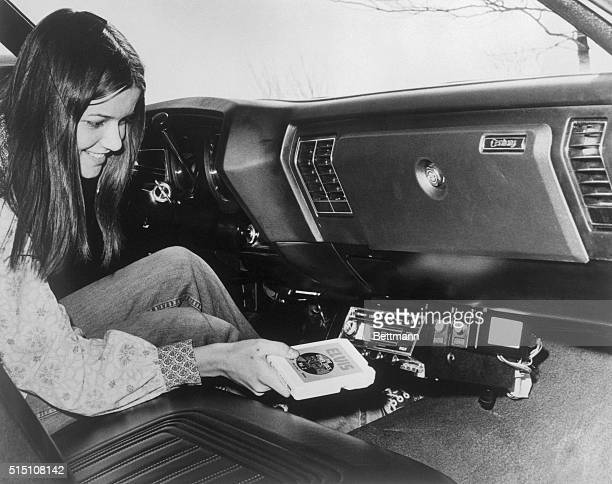 Rosemary Wilson loads an Elvis eight-track album into her new RCA 12R600 FM combination eight-track player and receiver.