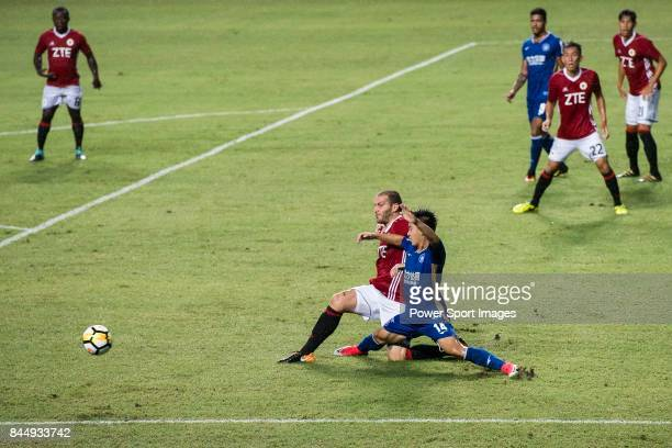 Rosen Kolev of Hong Kong Pegasus in action against Jiajie Zhang RF FC during the Premier League week two match between Hong Kong Pegasus and RF FC at...
