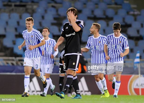 Rosenborg's midfielder from Norway Anders Trondsen gestures as Real Sociedad players celebrate their fourth goal during the Europa League football...
