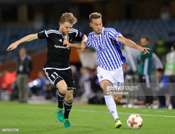 Rosenborg's midfielder from Norway YannErik De Lanlay vies with Real Sociedad's midfielder from Spain Sergio Canales during the Europa League...