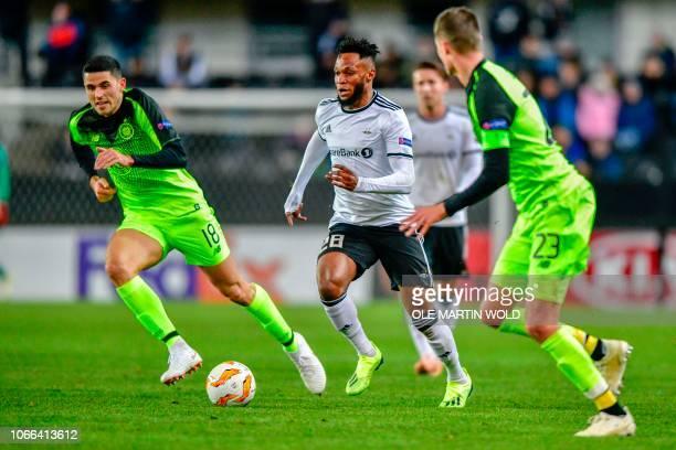 Rosenborg's Nigerian forward Samuel Adegbenro and Celtic's Australian midfielder Tomas Rogic vie for the ball during the UEFA Europa League group B...
