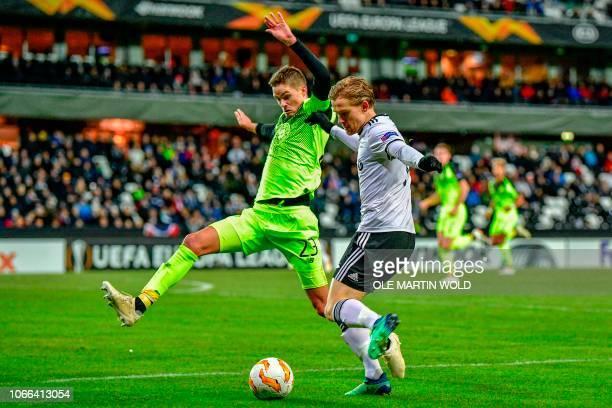 Rosenborg's Norwegian forward Yann De Lanley and Celtic's Swedish defender Mikael Lustig vie for the ball during the UEFA Europa League group B...