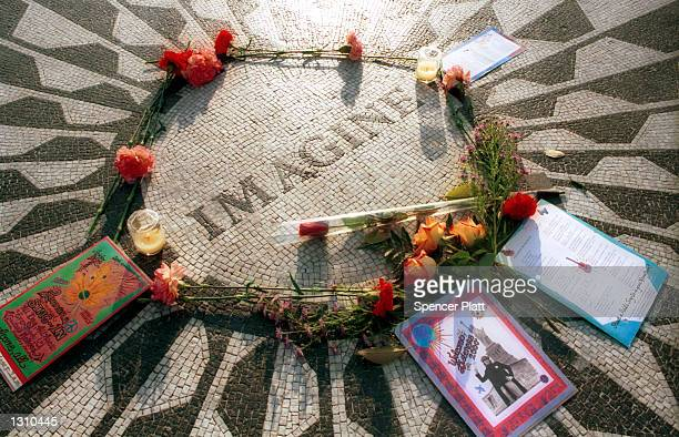 Roses and cards sit lay on the ''Imagine'' circle mosaic December 7 2000 in the area known as ''Strawberry Fields'' in New York City''s Central Park...