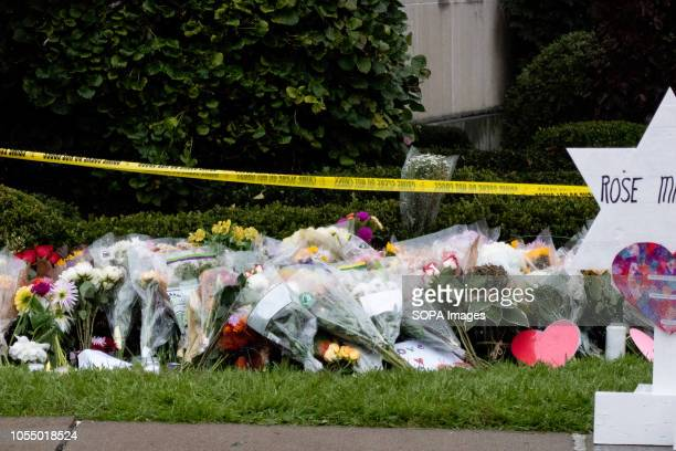 Roses and flowers sit at a makeshift memorial from the site of the mass shooting After the tragic shooting in Pittsburgh PA at the Tree of Life...