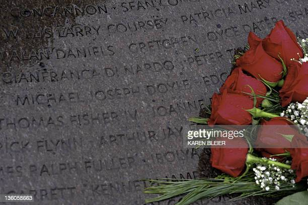 Roses are placed at the base of the Lockerbie Memorial Cairn during 23rd anniversary ceremonies December 21 2011 honoring the victims of Pan Am...