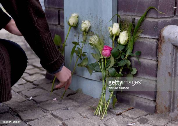 Roses are placed in front of a building of the Paula Fuerst comprehensive school in BerlinGermany 15 July 2016 Two pupils and a teacher of the...