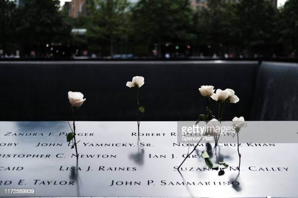 Roses are placed in the names of victims on the grounds of the September 11 Memorial and Museum on September 05, 2019 in New York City. New York City...