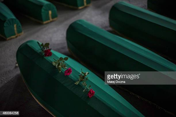 Roses are placed on a coffin among 136 coffins of victims of the 1995 Srebrenica massacre in the hall at the Potocari cemetery and memorial near...