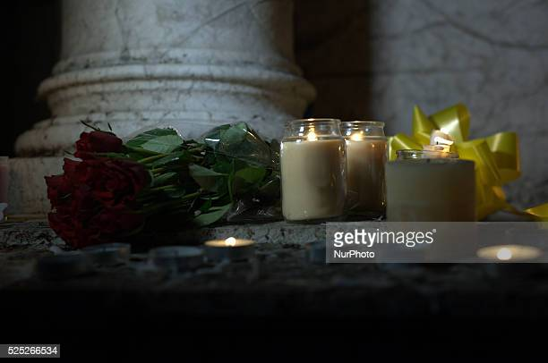 Roses candles and a yellow ribbon being laid on a statue in remebrance of Alan Henning on October 5 2014 in Manchester England A video purporting to...