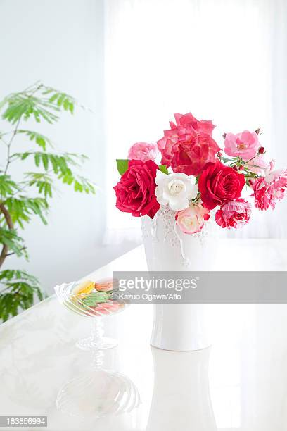 Roses in a vase and macaroons