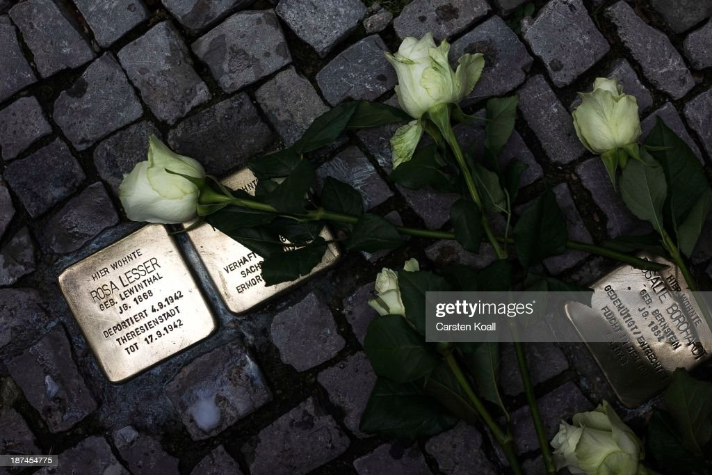 Roses lie on the ground between so called Stolpersteine, brass stumbling blocks, to commemorate the 75th anniversary of the Kristallnacht pogroms on November 9, 2013 in Berlin, Germany. Events are taking place across the country to commemorate the day in 1938 when Nazi followers across Germany and Austria burned down synagogues, smashed Jewish-owned businesses, looted Jewish residences and killed several hundred Jews. Anti-semitism was a central component of Adolf Hitler's rise to power and won him wide-spread sympathy among ordinary Germans and Austrians.