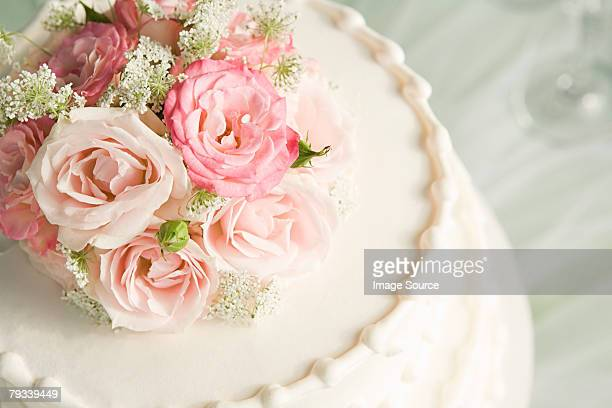 Roses on top of a wedding cake
