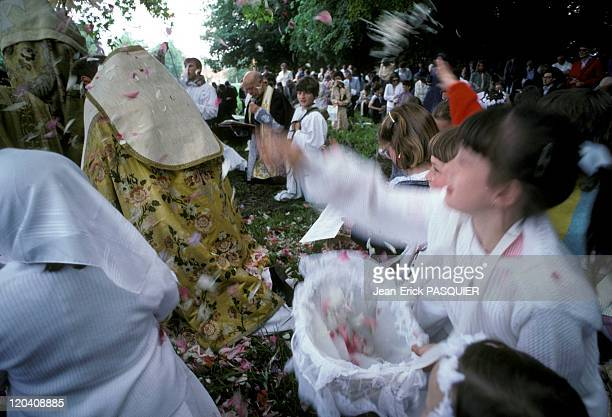 Roses Petals In France In 1987 Girls throwing rose petals on the participants in the procession of Corpus Christia Country Priest Father Quintin...