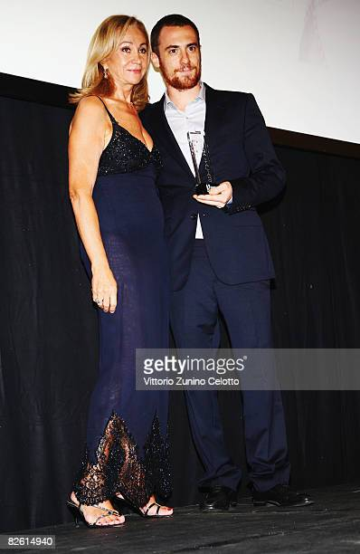 Rosetta Sannelli present actor Elio Germano with an award during the Kineo Diamanti al Cinema Award at the Hotel Des Bains during the 65th Venice...