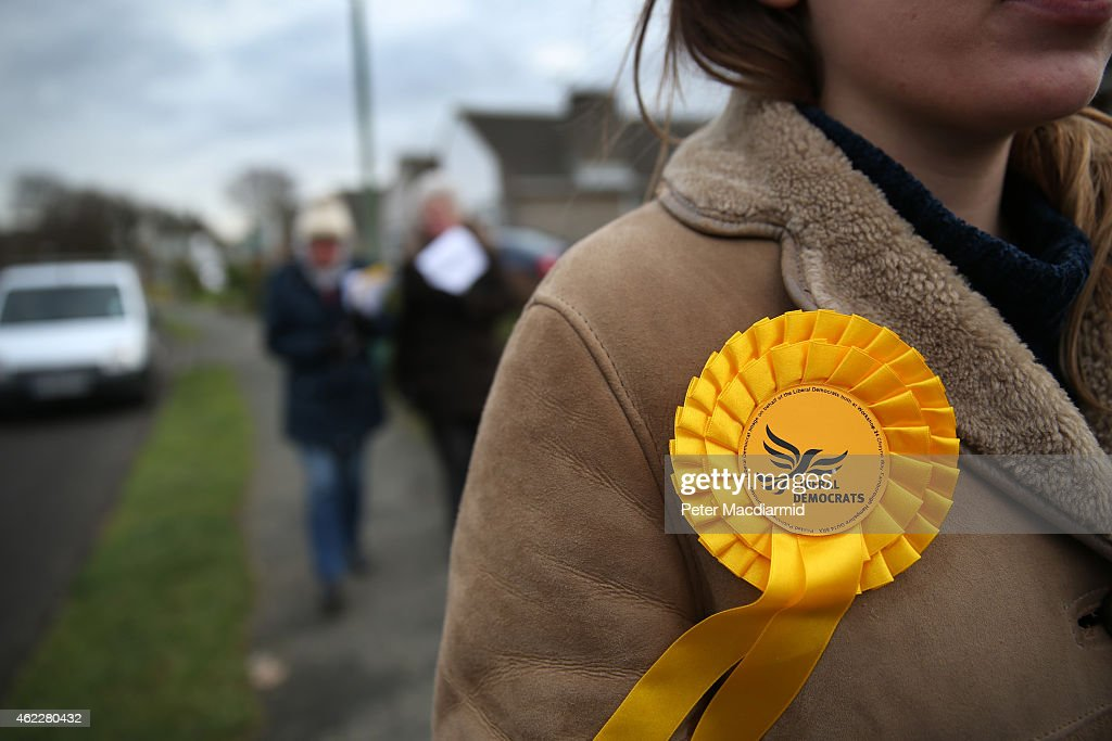 A rosette adorns a Liberal Democrat party workers as she helps candidate Jasper Gerard canvass for votes in the Maidstone and the Weald constituency on January 26, 2015 in Maidstone, England. Campaigning for the May 7th general election is well under way with just over 100 days to go to polling day.