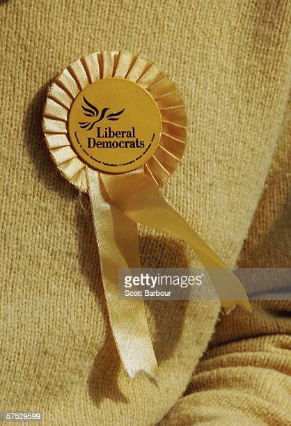 A rosette is pinned to the shirt of Liberal Democrat candidate James Kempton as he knocks on doors encouraging people to vote in Islington on May 4...