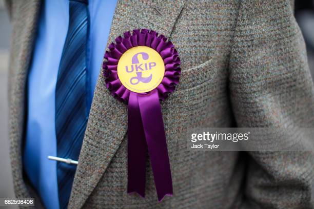 UKIP rosette sits on a supporters' lapel on May 12 2017 in Boston United Kingdom UKIP Leader Paul Nuttall has chosen to stand in the Boston and...