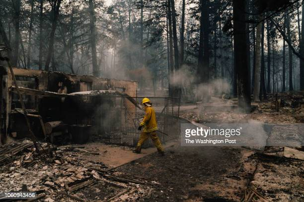 Roseville firefighters put out hotspots in Paradise California on November 12 2018 As of Monday morning Camp Fire is at 113000 acres with 25%...