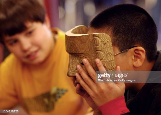 Roseville Mn Tues Nov 20 2002 Parkview Center School sixth grader Ben Kendall looks at his classmate sixth grader Jonathan Mak who is trying on a...