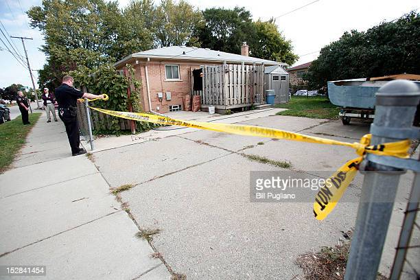 Roseville Police Officer Andrew Berger puts crime scene tape across the site where a tipster reported to police that the body of former Teamster's...