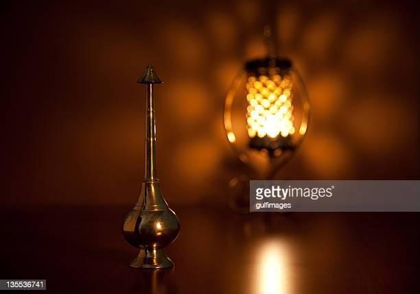 Rosewater sprinkler and illuminated lantern