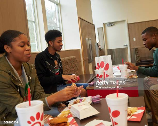 TALLAHASSEE FL Rosewood scholarship recipients Morgan Carter Chandraha CJ Srinivasa Jr and Darshae Spells eat ChikFilA while talking about campus...