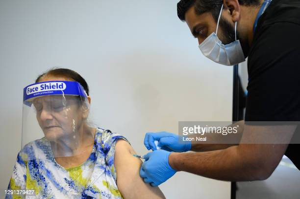 Roshan Velji receives the Pfizer/BioNTech Covid-19 vaccine at a vaccination clinic at the Sir Ludwig Guttmann Health and Wellbeing Centre on December...