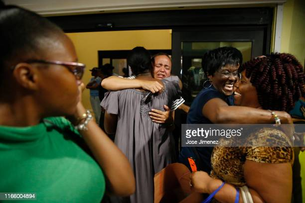 Roshane Eyma cries as she is greeted by members of her church after being rescued and flown to Nassau from devastated Abaco Island on September 4...