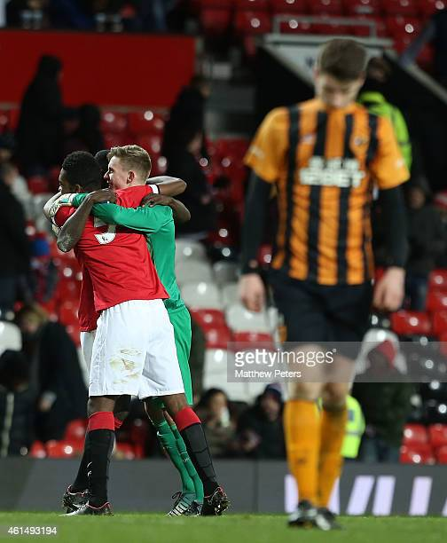 RoShaun Williams and Dean Henderson of Manchester United U18s celebrate after the FA Youth Cup Fourth Round match between Manchester United U18s and...