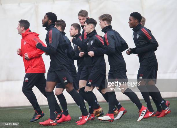 RoShaun Williams Dylan Levitt George Tanner and Tyrell Warren of Manchester United U19s in action during a training session at Vozdovac Stadium on...