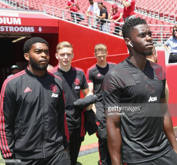 RoShaun Williams Ethan Hamilton Scott McTominay and Axel Tuanzebe of Manchester United arrive ahead of the preseason friendly match between...