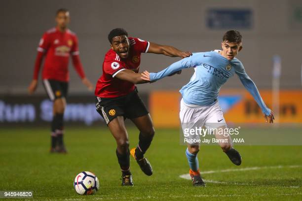 RoShaun Williams of Manchester United and Iker Pozo La Rosa of Manchester City during the Premier League 2 match at Manchester City Football Academy...