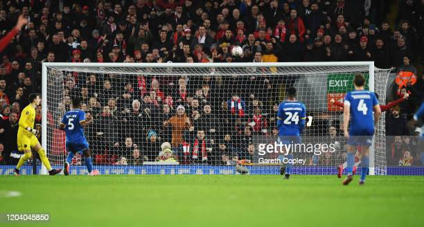 RoShaun Williams of Shrewsbury Town scores a own goal for Liverpool first goal of the game during the FA Cup Fourth Round Replay match between...