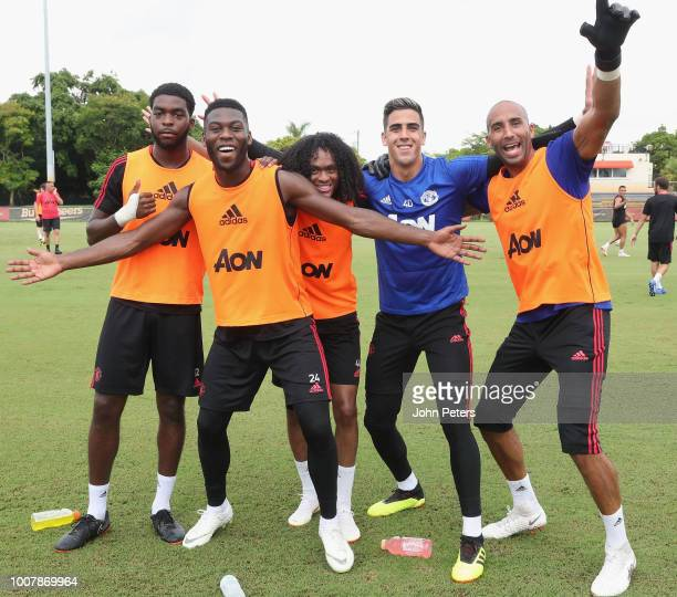 Ro-Shaun Williams, Timothy Fosu-Mensah, Tahith Chong, Joel Pereira and Lee Grant of Manchester United celebrate during a training session as part of...