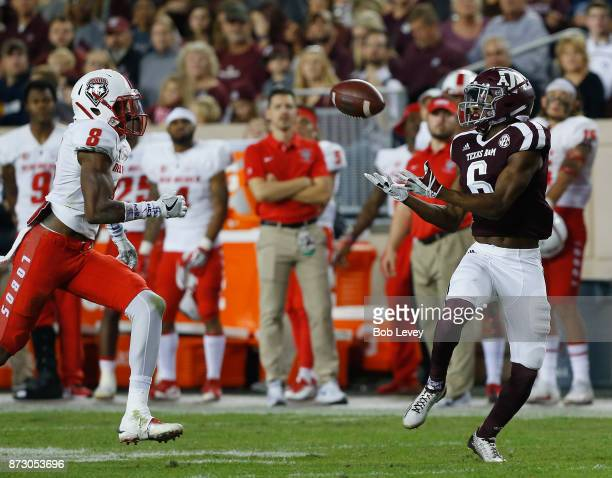 Roshauud Paul of the Texas AM Aggies makes a catch as he slips behind Willie Hobdy of the New Mexico Lobos at Kyle Field on November 11 2017 in...
