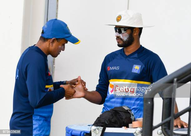 Roshen Silva of Sri Lanka gets ready to take part in a training session one day ahead of the 2nd Test between West Indies and Sri Lanka at Daren...
