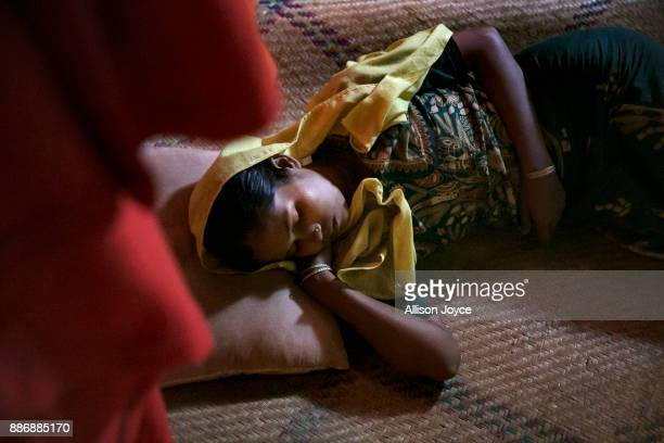 COX'S BAZAR BANGLADESH DECEMBER 01 Roshida Begum sleeps on December 1 2017 in Cox's Bazar Bangladesh She fled to Bangladesh shortly after the August...