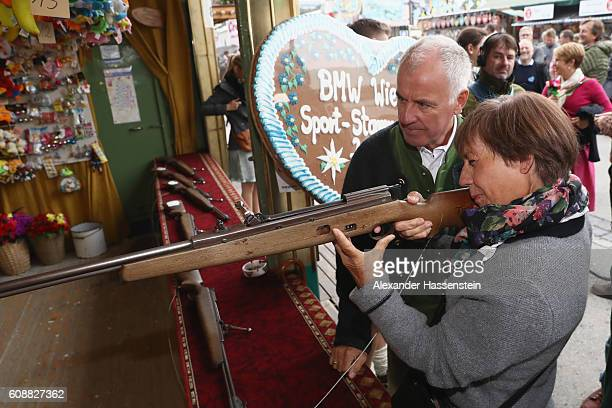 Rosi Mittermaier takes part in a shooting competition with Fritz Fischer during the BMW Wiesn SportStammtisch 2016 at Kafers Wiesn Schaenke beer tent...