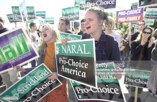 Rosia Warner at left and her sister Morgen Warner cheer speakers during a prochoice rally at the University Memorial Center on on the CU campus in...
