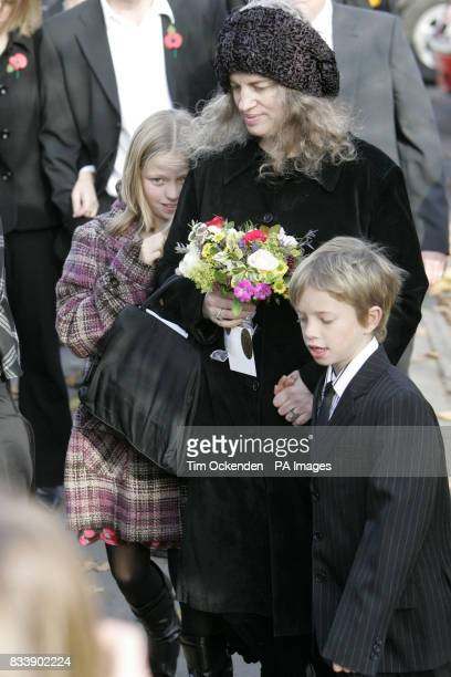 Rosie 11 and George Fry arrive at the memorial service for their parents who died in Portugal attempting to rescue them with thier Lesley Spencer at...