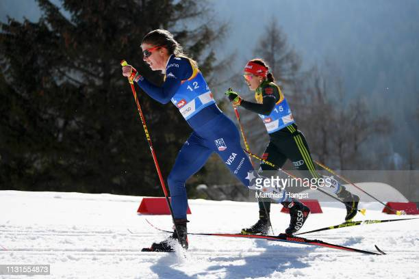 Rosie Brennan of the United States and Katharina Hennig of Germany compete in the Cross Country Skiathlon Ladies 15k race during FIS Nordic World Ski...