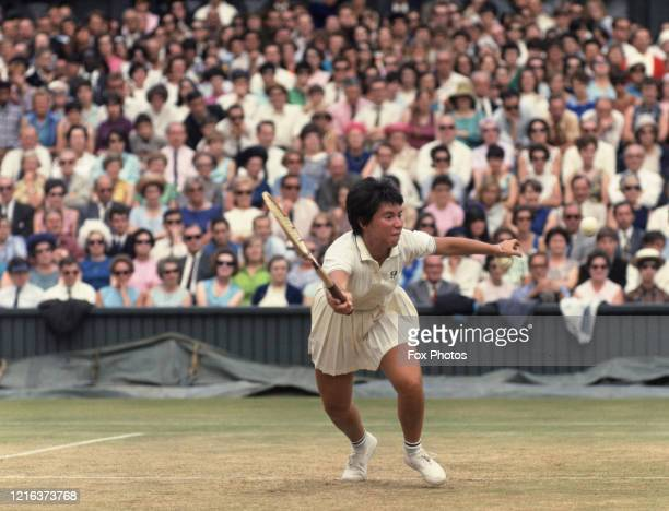 Rosie Casals of the United States reaches for a forehand return against Ann Jones during their Women's Singles SemiFinal match at the Wimbledon Lawn...