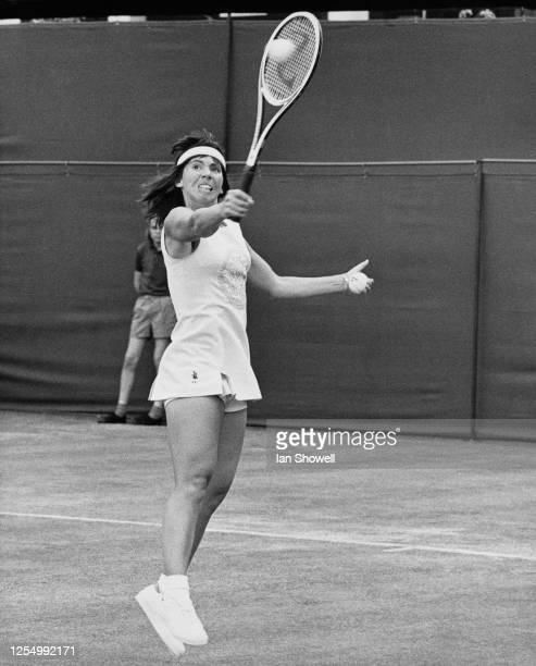 Rosie Casals of the United States reaches to deliver a backhand return on her way to defeating Sue Mappin of Great Britain 63 64 in their Women's...