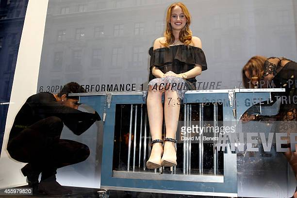 Rosie Fortescue and magician Troy seen performing in the window of French Connection Regent Street at French Connection Vogue Fashions Night Out...