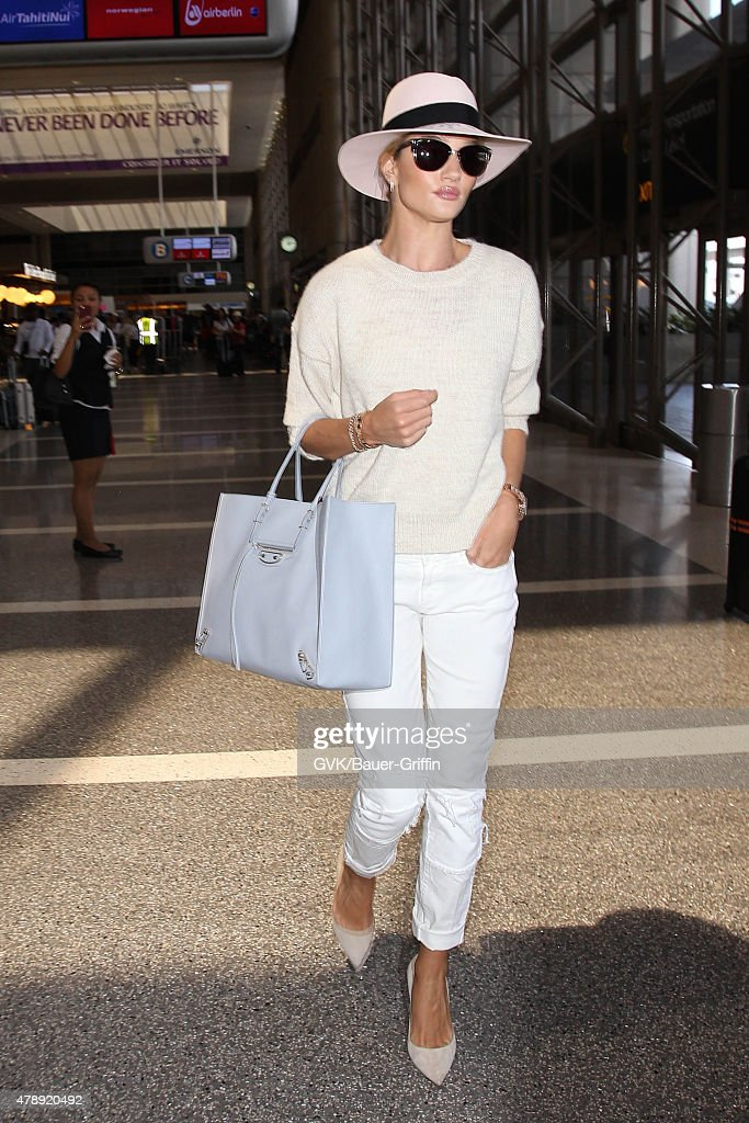 Rosie Huntington Whiteley is seen at LAX. on June 28, 2015 in Los Angeles, California.