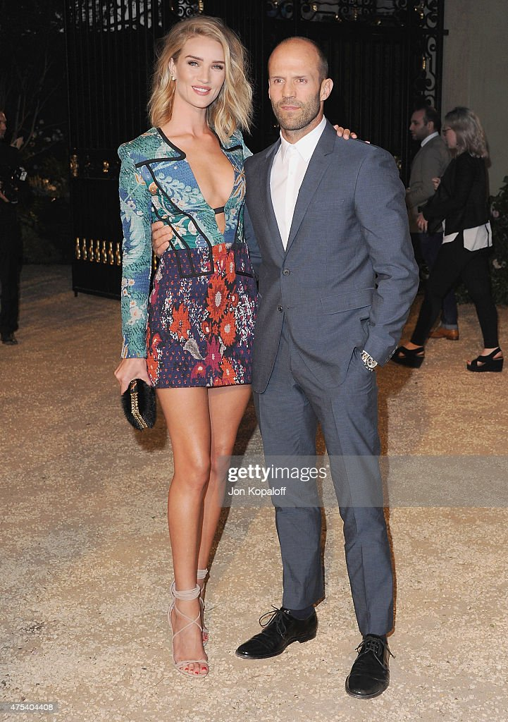 Rosie Huntington-Whiteley and actor Jason Statham attend the Burberry 'London in Los Angeles' event at Griffith Observatory on April 16, 2015 in Los Angeles, California.