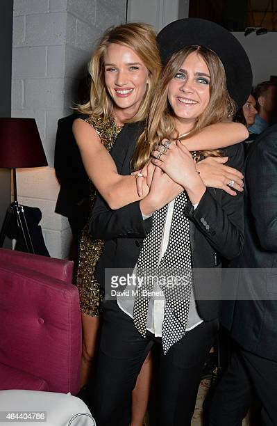 Rosie HuntingtonWhiteley and Cara Delevingne attend the Universal Music Brits party at The Soho House PopUp on February 25 2015 in London England