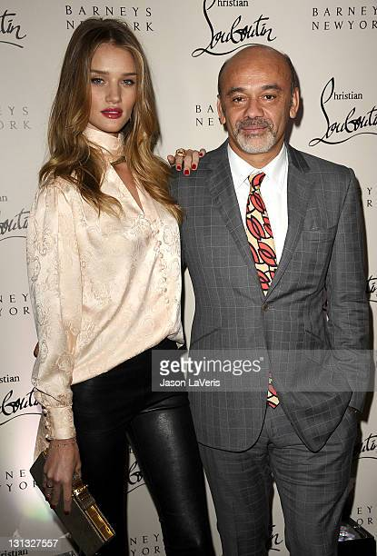 Rosie HuntingtonWhiteley and designer Christian Louboutin attend the Christian Louboutin book launch party at Barney's New York on November 3 2011 in...