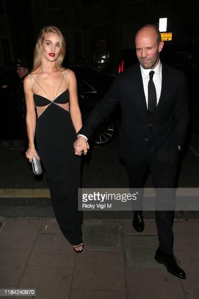 Rosie HuntingtonWhiteley and Jason Statham seen attending Harper's Bazaar Women of the Year Awards at Claridge's on October 29 2019 in London England