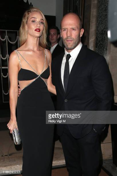 Rosie HuntingtonWhiteley and Jason Statham seen attending Harper's Bazaar Women of the Year Awards at Claridge's on October 29 2019 in London England